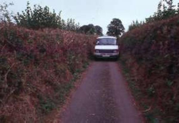 Car driving on narrow road