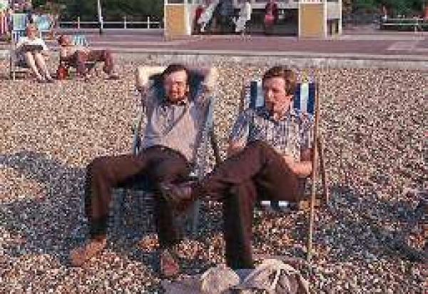 Alun and Bill sitting in lawn charis