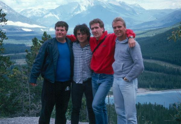 Four students mountains in background