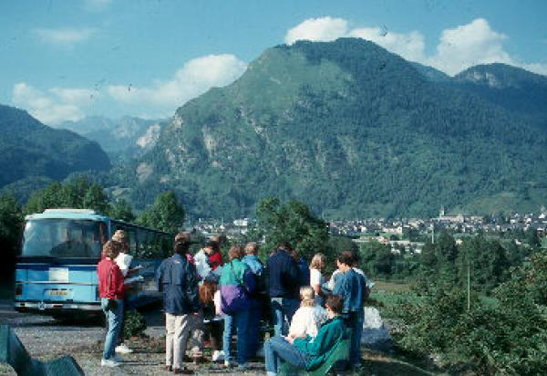 Students listening to lecture mountain in background