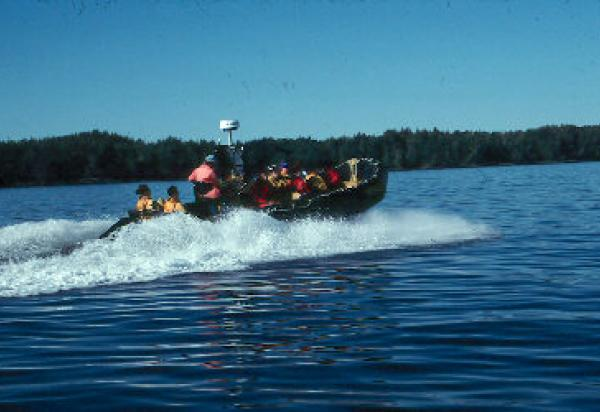 Students riding in motor boat