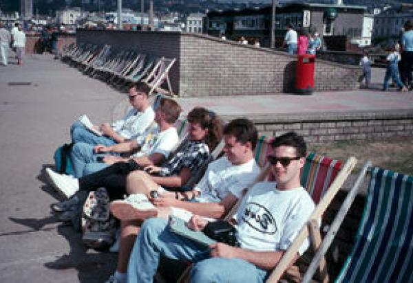 Street scene with students sitting in lawn chairs