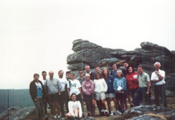Group shot in front of big rock