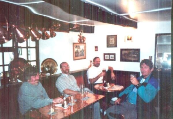 Faculty enjoying time in a pub