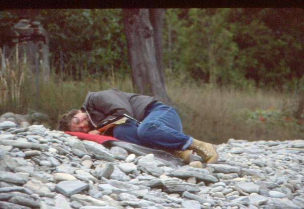 Student napping on rocks