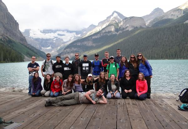 Class of 2013 on wood deck with moutains and lake