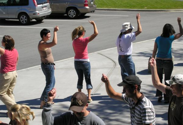 Students dancing on a street, close up view