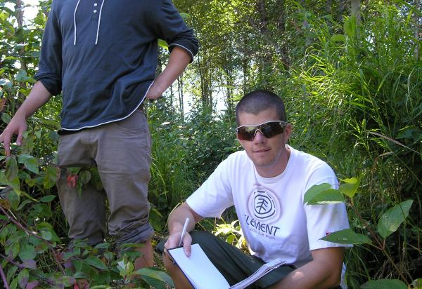Two students collecting data in field