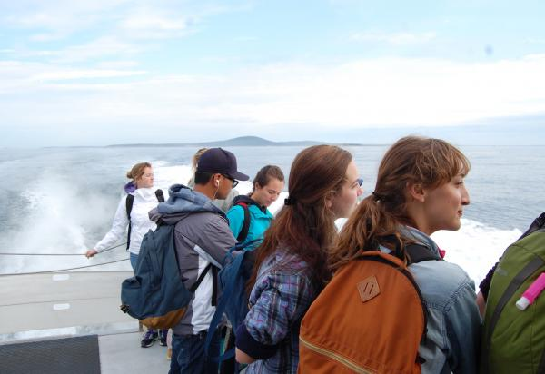 Students looking over side of boat
