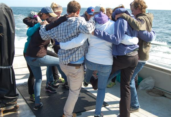 Group hug on boat