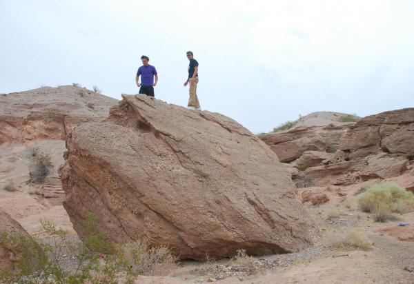 Two students up high on a rock