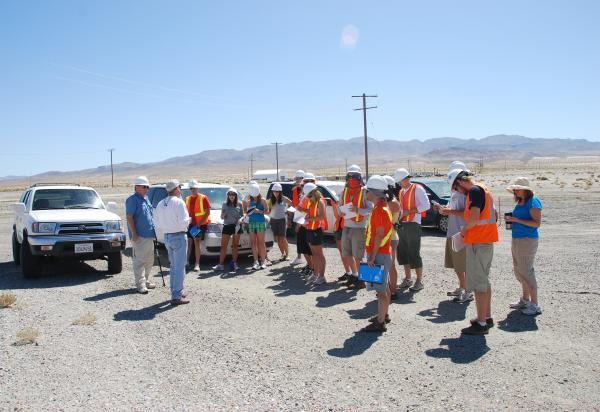 Students roadside desert taking notes