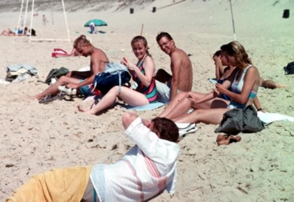 students relaxing on beach